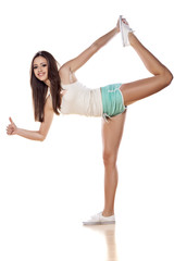 flexible smiling girl showing thumbs up