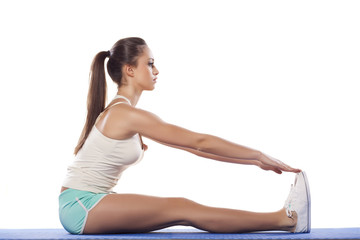 pretty young woman doing stretching exercise