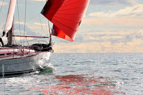 red sail at sunset