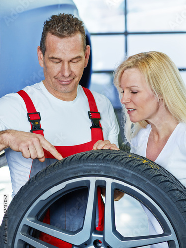 Car mechanic explains the tread depth of a tire