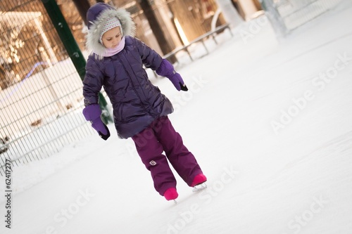 Little girl learns to skate