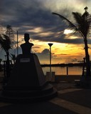 Sunset with statue silhouette