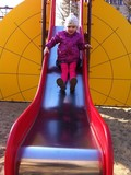 child sliding on playground