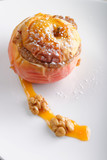 Baked apples with nuts, candied fruits, honey and sugar.