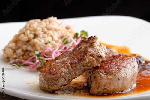 Grilled pork tenderloin with prunes and buckwheat