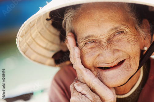 Poster Old and beautiful smiling senior woman.