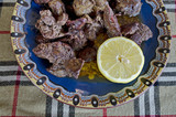 Portion of chicken liver roasted with butter and shorn lemon
