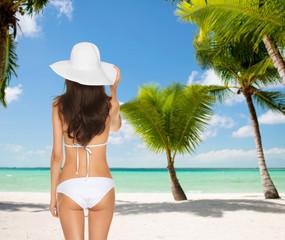 woman posing in white bikini