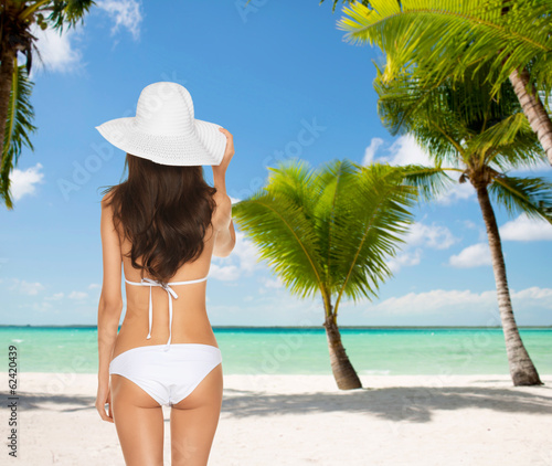 woman posing in white bikini