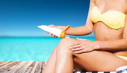 girl putting sun protection cream on berth