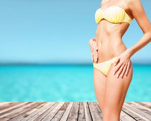 closeup of female body in bikini at beach