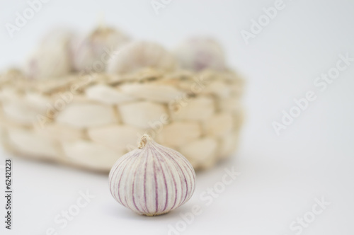 one garlic bulb and garlic basket