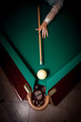 woman aiming at billiard pocket with white ball