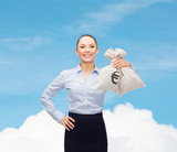 young businesswoman holding money bags with euro