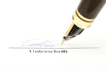 Unterschrift mit Feder
