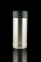 Stainless vacuum bottle on black background