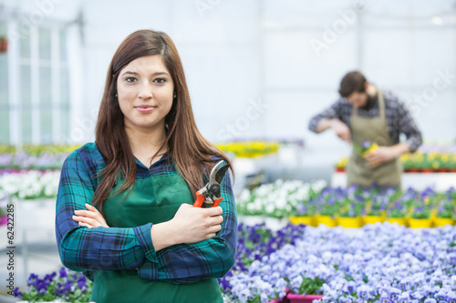 Happy  men and female florist working