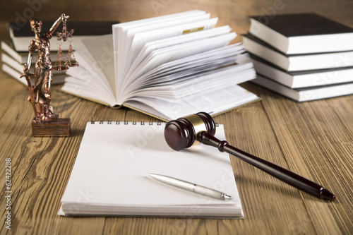 Final speech, notebook, Lady of justice, gavel and books on wood