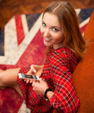 Portrait of happy young woman with mobile phone