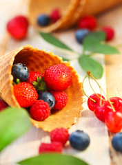 Wafer cups with strawberry, cherry, raspberry and blueberry