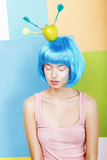 Eccentric Woman Oddball in Blue Wig with Darts and Green Apple