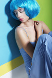 Daydream. Relaxation. Woman in Blue Wig Sleeping