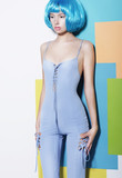 Vogue. Young Woman in Blue Overalls and Creative Wig posing