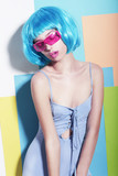Extravagant Woman in Styled Blue Wig and Pink Sunglasses