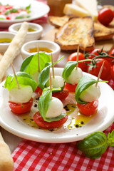 Appetizers; mini mozzarella, cherry tomatoes and basil
