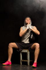Young boxer praying fervently for a win
