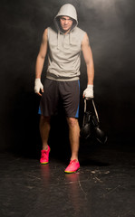 Despondent young boxer leaving after a defeat