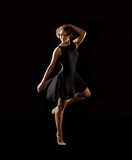 Ballerina on black background