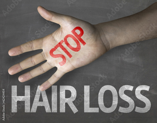 Hair Loss educational and creative sign on blackboard