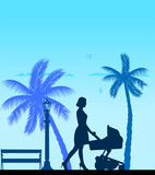 A young mother pushing the stroller and walk the beach