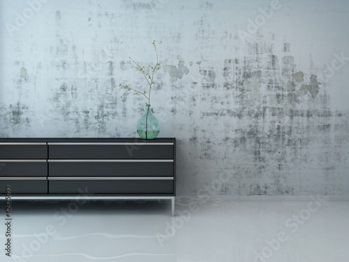 Stylish black cupboard against concrete wall