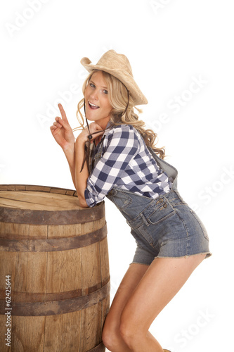 cowgirl overalls lean on barrel