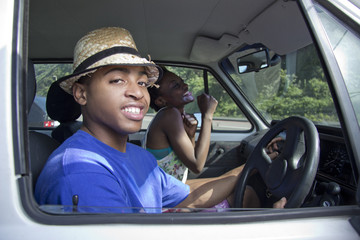 Black Couple playful laughing in a car