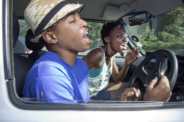 Black Couple super excited  in a car