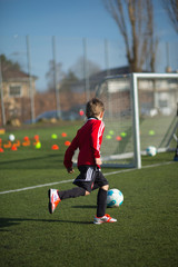 Boy practicing soccer