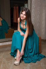 Beautiful woman in a turquoise dress