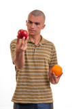 young man comparing apples to oranges