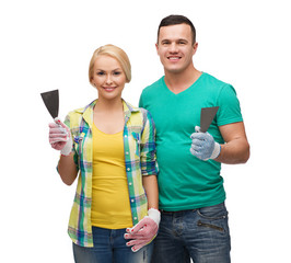 smiling couple in gloves with spatula
