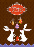 Easter card with bunnies on chocolate background.