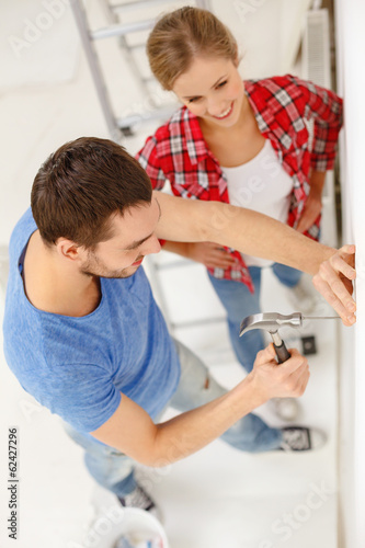 smiling couple renovating new home