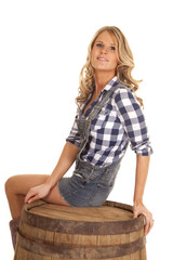 woman overalls sit on barrel look