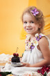 Pretty little girl posing with chocolate cake
