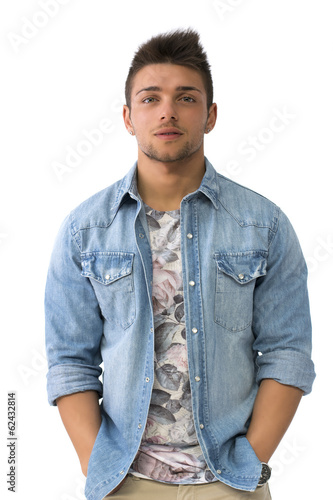 Handsome young man standing with open denim shirt