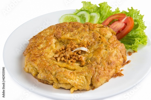 close up of omelette isolated on white dish