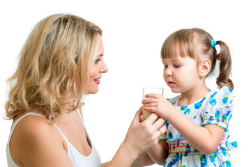 mother giving milk drink to kid