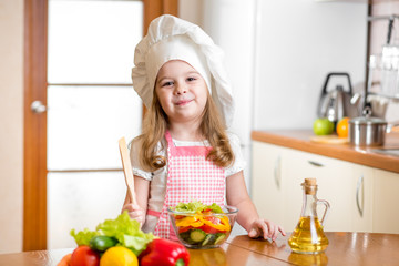 kid girl preparing healthy food vegetable salad